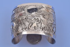 "Navajo dead-pawn sterling silver ""storyteller"" cuff"