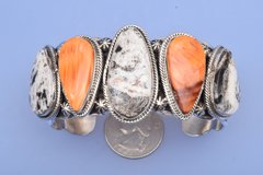 Sterling silver Navajo cuff with White Buffalo and orange spiney oyster shell by Marcella James, Navajo.