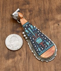 Inlaid pendant with orange spiney oyster shell by Ray Jack, Navajo