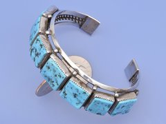 Large-sized dead-pawn Sterling silver cuff with seven Sleeping Beauty turquoise pieces.