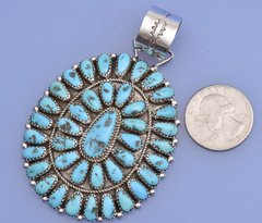 Exquisite cluster pendant with 40 Sleeping Beauty turquoise stones by E. Wilson, Navajo.—SOLD!
