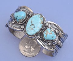 Navajo Sterling triplet cuff with Kingman turquoise by Gilbert Tom.