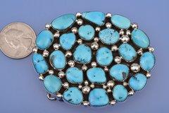 Navajo belt buckle with 22 Sleeping Beauty turquoise stones.