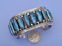 New Navajo Sterling silver cuff with ten turquoise settings..