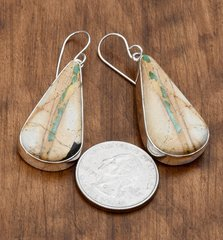 Sterling Navajo earrings with ribbon/boulder turquoise.