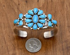 """Sterling Navajo cluster cuff with 17 """"clear"""" Sleeping Beauty mine turquoise stones."""