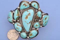 Dead-pawn Navajo Sterling cuff with Pilot Mountain mine turquoise.