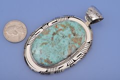 Large Navajo pendant with Cripple Creek turquoise by Eloise Kee.