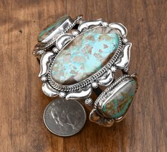 Tiny wrist-size Navajo Sterling triplet cuff with ribbon/boulder turquoise and repousse' silversmithing by Gilbert Tom.—SOLD!