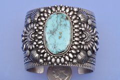 Wide Navajo Sterling cuff with Pilot Mountain turquoise by Darryl Bicenti.