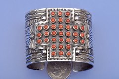 Sterling silver and red coral Navajo cuff by Sunshine Reeves.