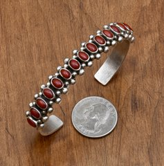 Navajo dead-pawn Sterling cuff with 15-pieces of Mediterranean blood-red coral.
