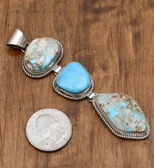 Navajo Sterling three-piece pendant with ribbon/boulder and Kingman turquoise
