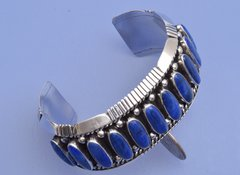 Sterling Navajo cuff with eleven Lapis stones by Tom Lewis