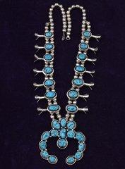 Navajo dead-pawn squash blossom necklace.