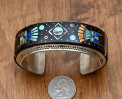 Intricate inlaid cuff by Matthew Jack, Navajo.