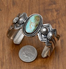 Navajo Sterling cuff with exquisite hand-stamping and Royston turquoise by Leon Martinez.