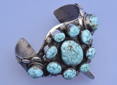 Custom-made Sterling Navajo cuff with eleven aqua-blue natural Kingman turquoise stones by Gilbert Tom.