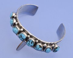 Smaller dead-pawn Navajo cuff with eight Sleeping Beauty turquoise stones.—SOLD!