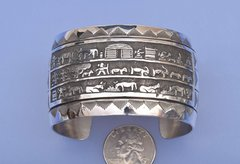 Dead-pawn Navajo Sterling silver storyteller cuff.
