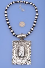 Very large Navajo white buffalo pendant with Navajo-pearl silver-bead necklace by Lorenzo James