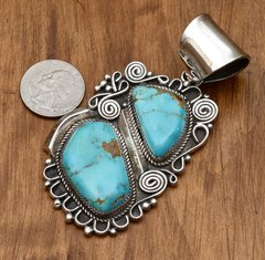 Dead-pawn ornate Navajo Sterling pendant.