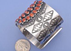 Trophy Navajo cuff with 62 coral settings by Anthony Skeets.