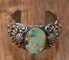 Exquisite Navajo Sterling cuff with repousse' and Royston, Nevada turquoise—by Marcella James.
