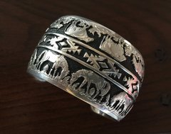 Navajo Sterling storyteller-type double-overlay cuff with cattle and horses.