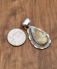 Small Navajo Sterling pendant with Royston turquoise by Alfred Martinez.