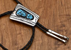 Navajo dead-pawn Sterling bolo tie with custom tips and Sleeping Beauty turquoise.