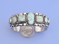 Sterling Navajo cuff with seven Dry Creek turquoise stones by G. James.—SOLD!