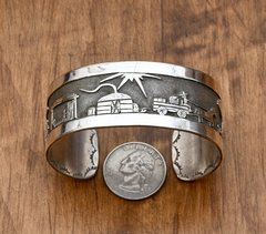 "Dead-pawn Navajo Sterling storyteller cuff by ""Harvey."""