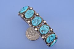 Dead-pawn Navajo cuff with seven Sleeping Beauty turquoise settings.