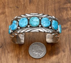 Dead-pawn classic Navajo row cuff with seven Sleeping Beauty turquoise stones.