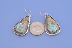 Navajo Sterling earrings with ribbon (boulder) turquoise.