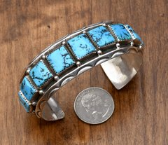 Man's dead-pawn Navajo Sterling cuff with thirteen squared Sleeping Beauty turquoise stones.