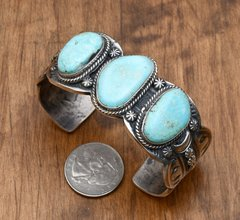 Navajo triplet cuff with Turquoise Mountain turquoise by Gilbert Tom.
