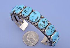Larger wrist-size dead-pawn Navajo cuff with eleven Sleeping Beauty turquoise stones.