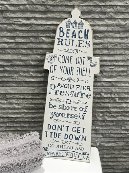 Lighthouse Shape With Beach Rules Sign