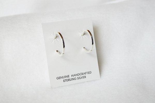 Sterling silver medium hoop post earrings. E340