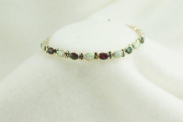 "Sterling silver black and white opal 7.75"" link bracelet. B065"