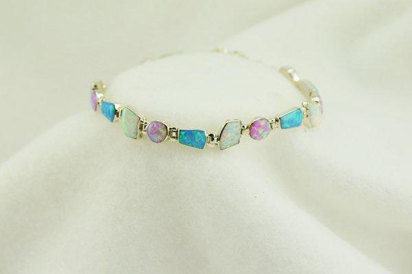"Sterling silver white, pink and blue opal multi shape stone link 8"" bracelet. B076"