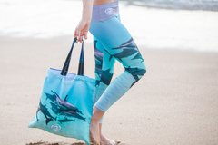"""The """"New Dolphin Pod"""" Features a beautiful pod of dolphins wrapping around your legs with a wide dolphin grey waistband #KeepThemWild"""