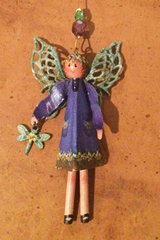 Patina the Garden Angel with accessory of choice