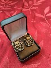 Skull and crossbones cufflinks carved from a real human tibia