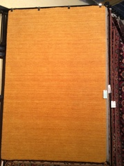 Solid camel colored hand hooked wool 5x8 rug