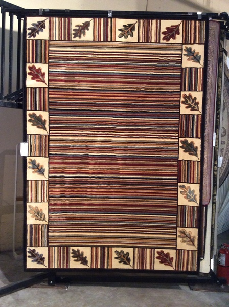 Multi-colored autumn pattern 5x8 machine-made rug.sold out