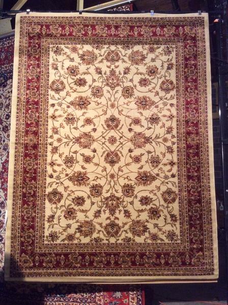 Creme persian design all over 8x11 machine made rug