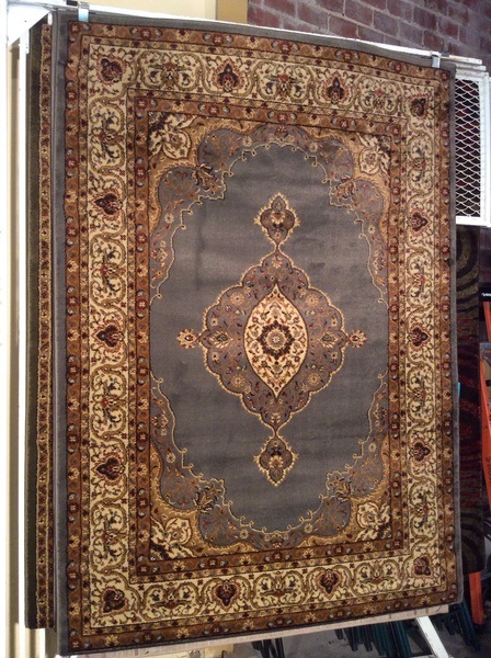 Persian open field design 5x8 machine made rug.sold out